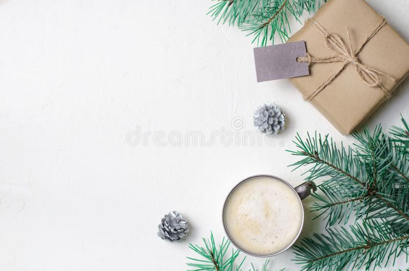 Winter Concept, Christmas Gift, Coffee Mug, Pine Cones and Braches, Cozy Still Life Background royalty free stock photo