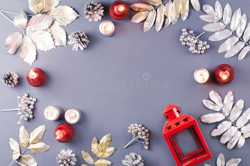 Winter concept flat lay with silver leaves, lantern, candles and hot coffee. Christmas frame background stock photography
