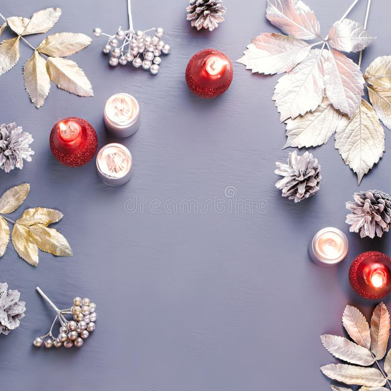 Winter concept flat lay with silver leaves, lantern, candles and hot coffee. Christmas frame background stock images
