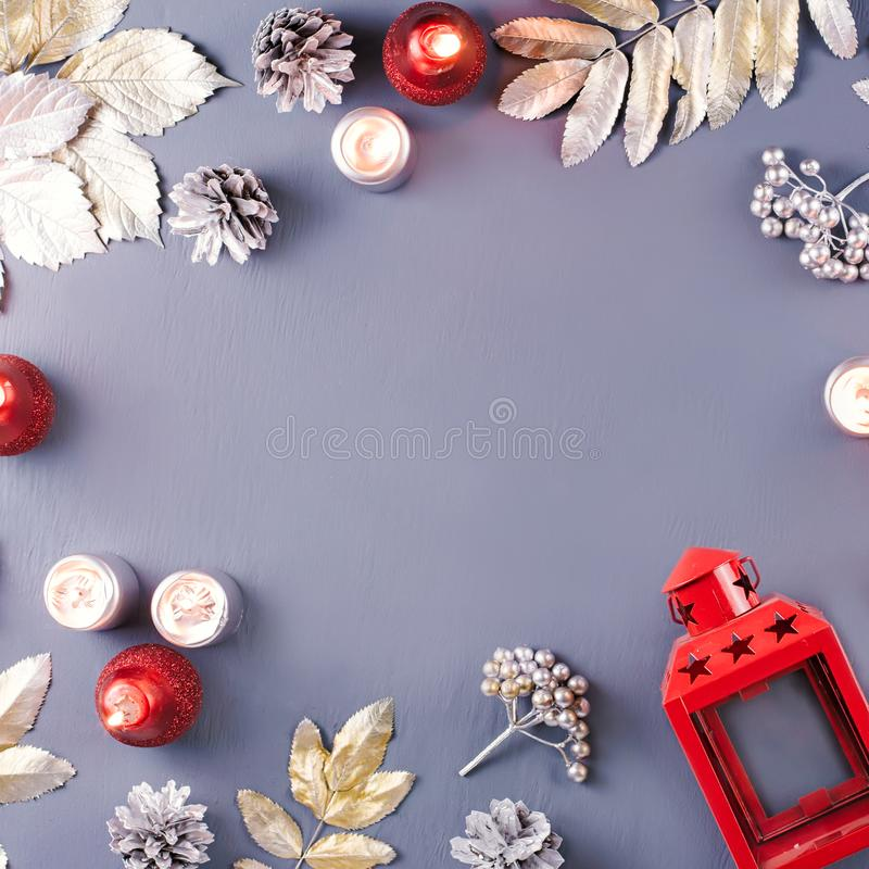 Winter concept flat lay with silver leaves, lantern, candles and hot coffee. Christmas frame background. Winter concept flat lay with silver leaves, lantern stock photography