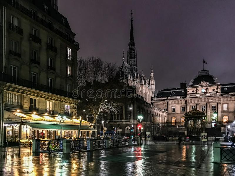 The Conciergerie, Sainte Chapelle, and adjacent cafes on a winter night, Paris, France. Winter 2018: The Conciergerie, Sainte-Chapelle, and adjacent cafes on the stock photos