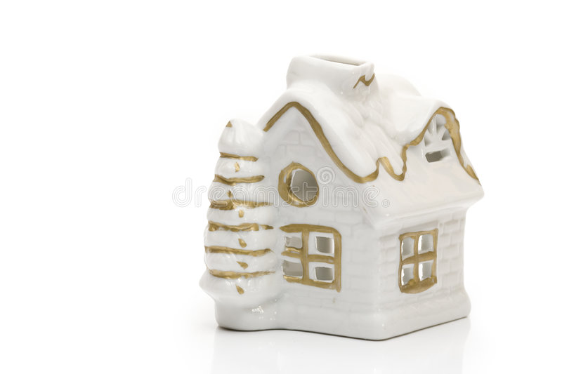 Winter cottage. Winter ceramic little cottage on white background royalty free stock photography