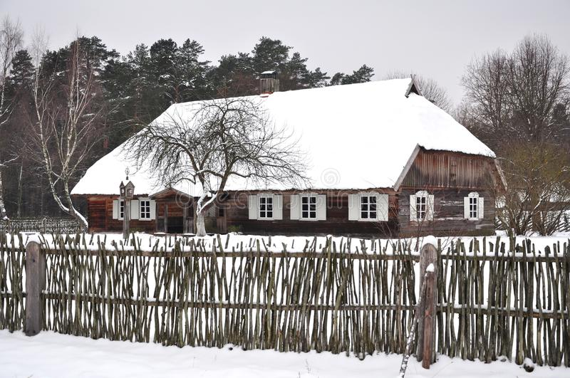 Winter country house. Winter scene of etnographic country house in rumsiskes, lithuania royalty free stock image