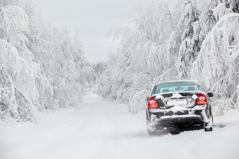 Winter country road with car on roadside royalty free stock photography