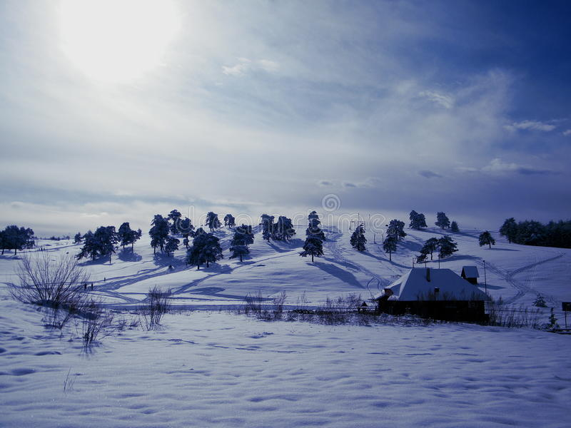 Winter country in Serbie. Winter landscape in snowy serbian close to bosnian border with sun in the apex royalty free stock images