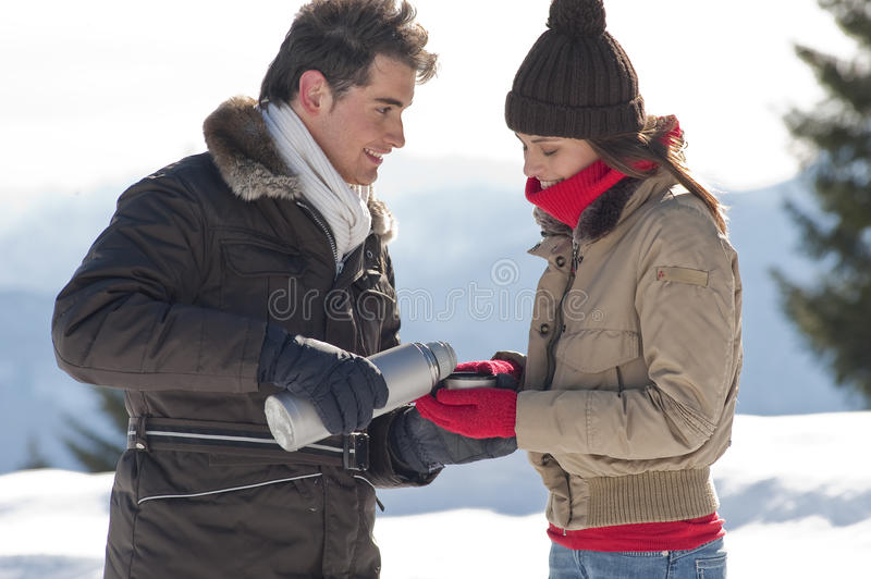 Download Winter Couple With Hot Drinks Stock Photo - Image of insulated, jacket: 27534338