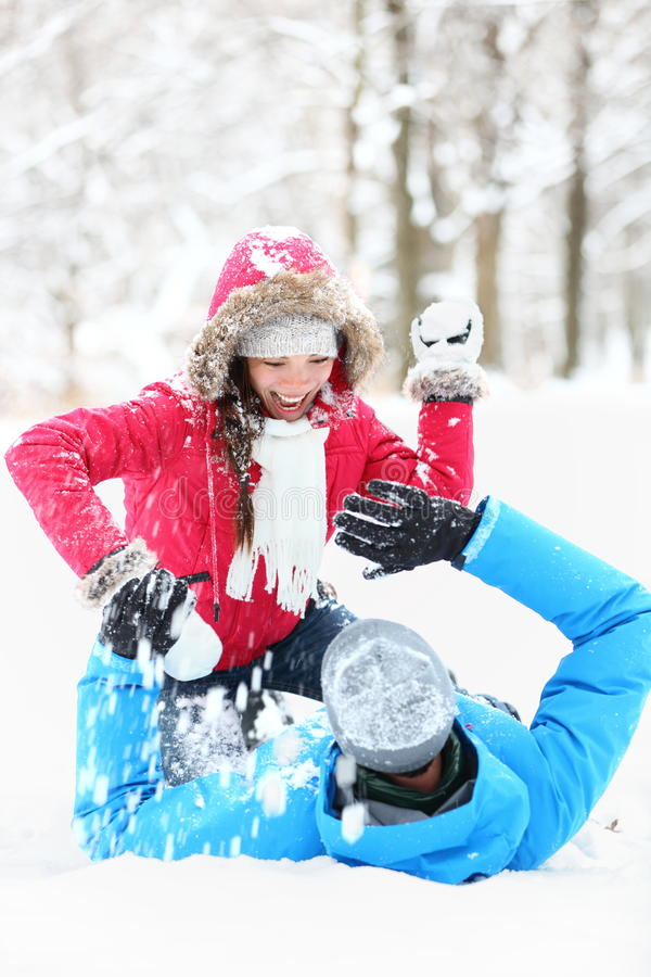 Free Winter Couple Snowball Fight Royalty Free Stock Photos - 22656748