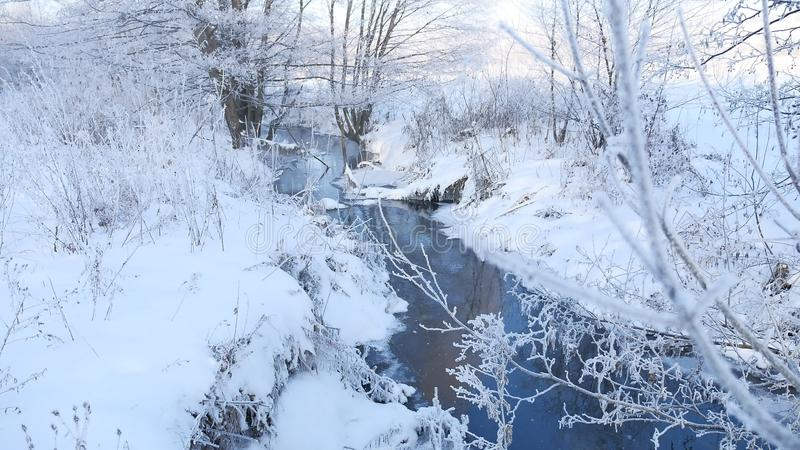Winter creek in the forest snow, frozen branches of trees landscape nature. Winter creek in forest snow, frozen branches of trees landscape nature stock photography