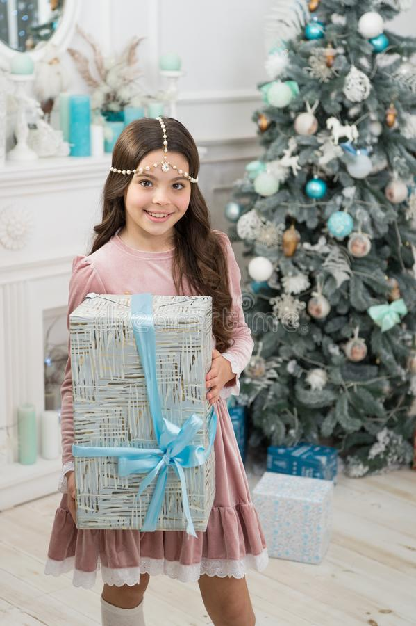 Winter decorations. Magical atmosphere. Boxing day. Open gift. Winter wonderland. Adorable girl hold big box christmas. Eve. Present concept. Smiling child royalty free stock photos