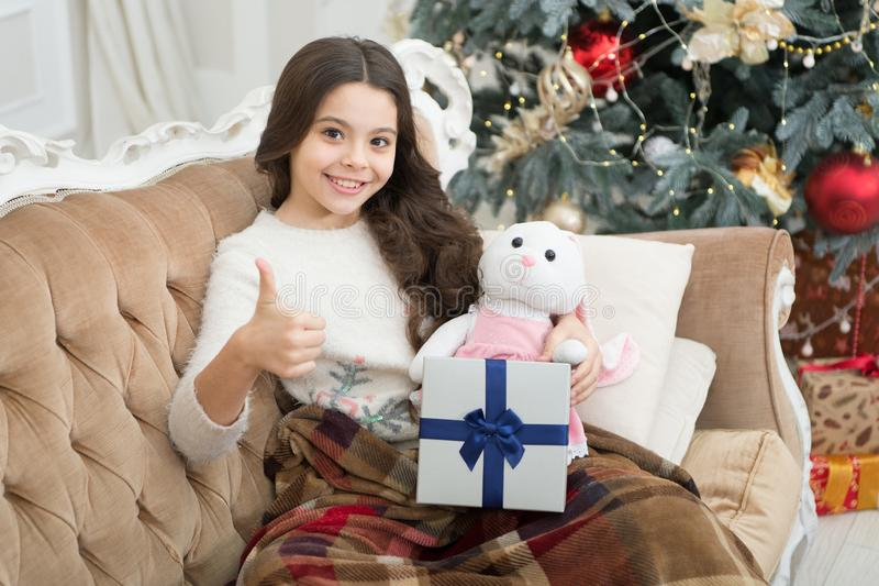 Winter decorations. Magical atmosphere. Boxing day. Open gift. Winter wonderland. Adorable girl play with toy in. Christmas eve. Present concept. Smiling child royalty free stock photography