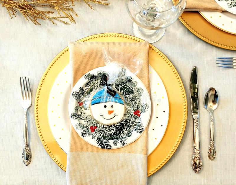 Winter Dinner Table Setting with Snowman royalty free stock photography