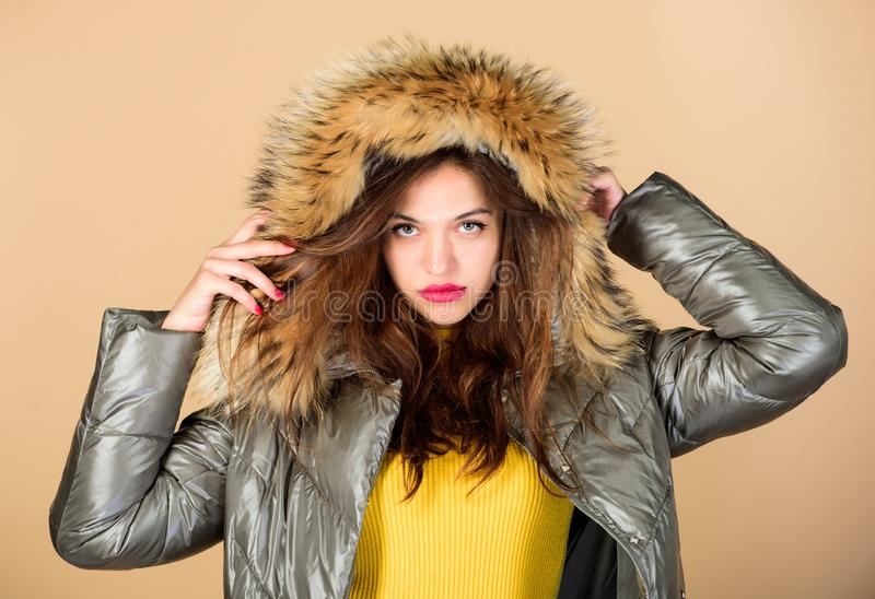 Winter dreaming. woman in padded warm coat. happy winter holidays. beauty in winter clothing. cold season shopping. girl. In puffed coat. faux fur fashion. flu stock photos