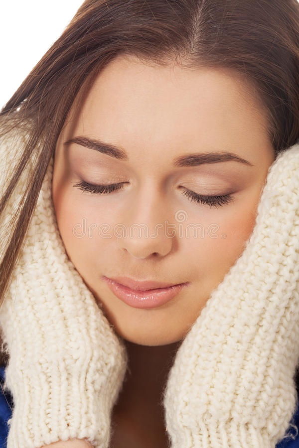 Winter dreams. Portrait of a girl in winter gloves on isolated white royalty free stock image