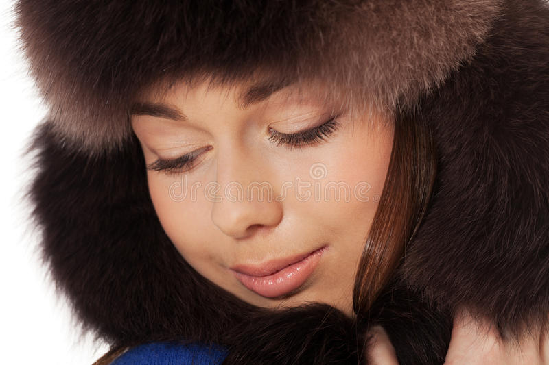 Winter dreams. Portrait of a girl in winter clothes on isolated white royalty free stock image