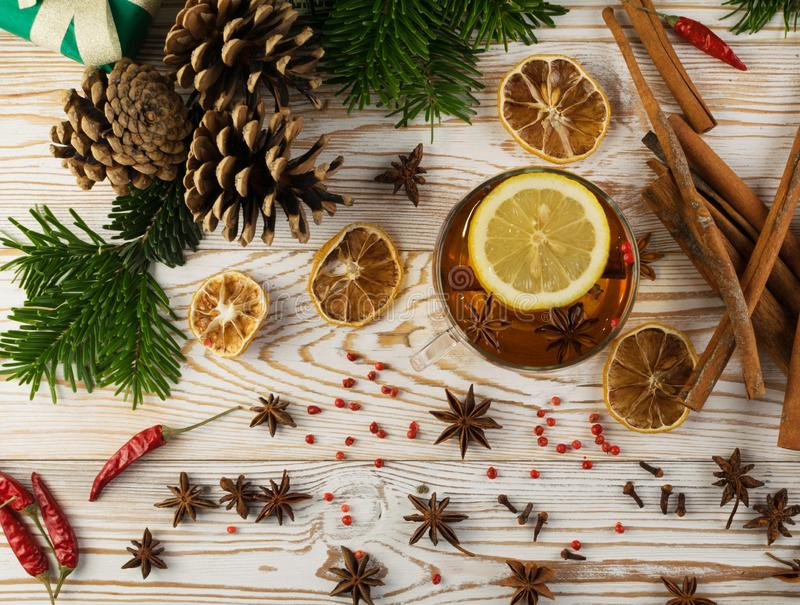 Winter drink with spices on festive new year background royalty free stock image