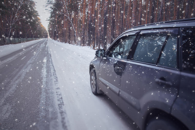 Winter drive car in winter forest stock image