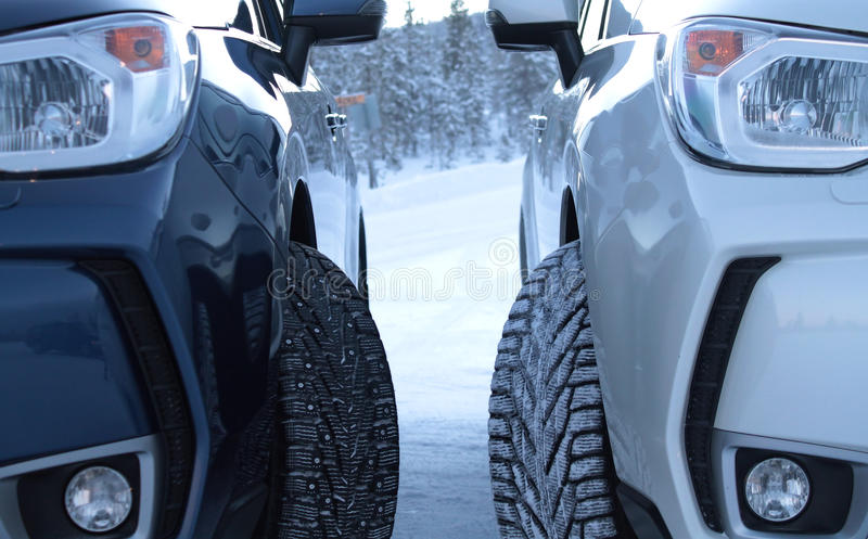 Winter drive safety. Studded tires against studless tires stock photo