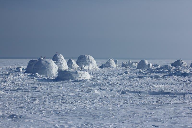 Igloo. Eskimos village. Winter dwelling of Eskimos. Igloo. Eskimos village. Winter background royalty free stock photos