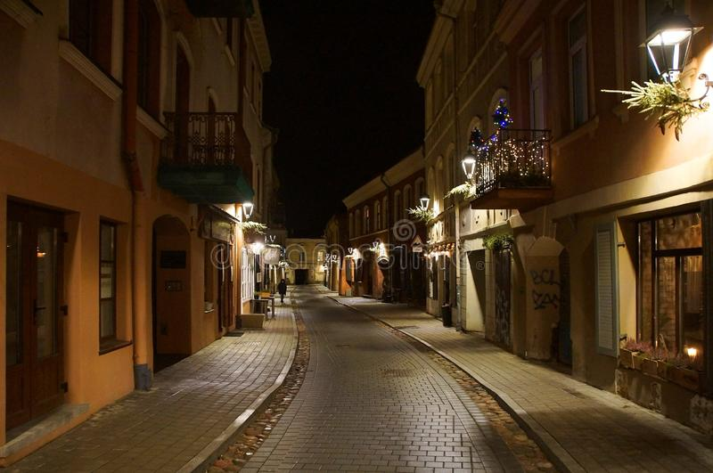 Winter evening on the narrow street of the old town stock photography