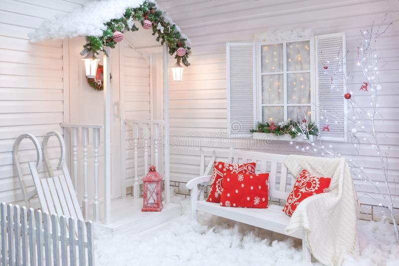 Winter exterior of a country house with Christmas decorations. Winter exterior of a country house with Christmas decorations in the American style. Snow-covered royalty free stock photo