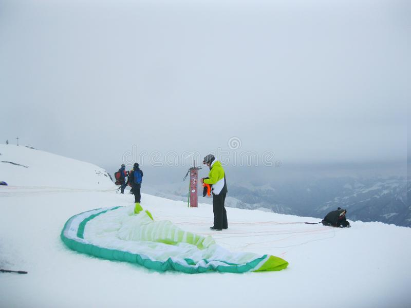 Winter.Extremal Sport ` Para-plan `.Higher Mountains.Travel.Sport.Blue Sky. Gudauri Mountain Resort in Georgia.The highest point of the resort: 3300 meters stock photo