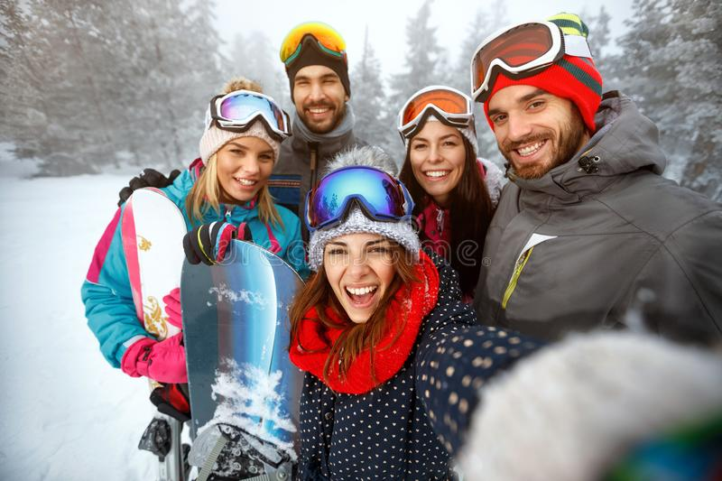 Winter, extreme sport and people concept - friends having fun on royalty free stock photos