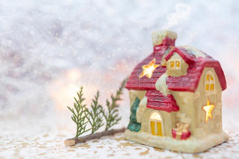 Winter fairytale house, snowy background stock photography