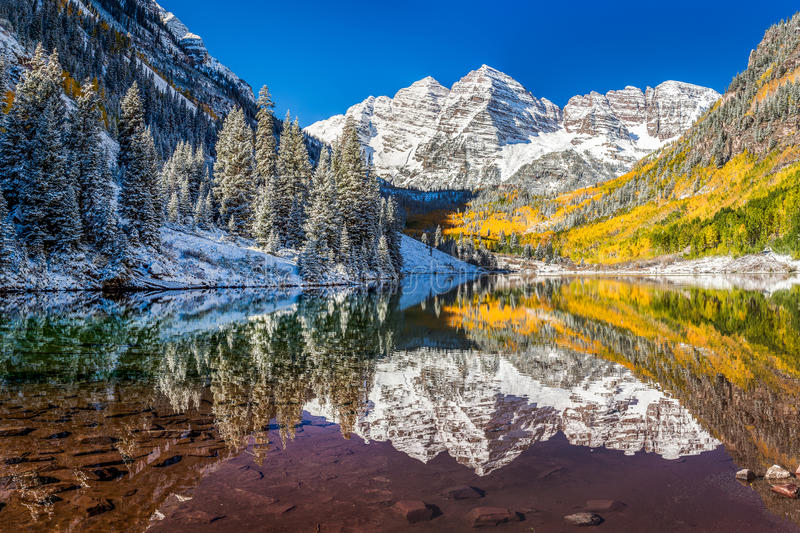 Winter and Fall foliage at Maroon Bells, CO. Winter and Fall foliage at Maroon Bells, Aspen, CO royalty free stock photo