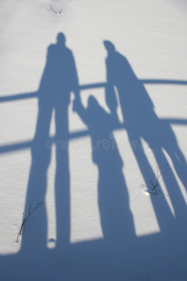 Winter family shadow royalty free stock photo