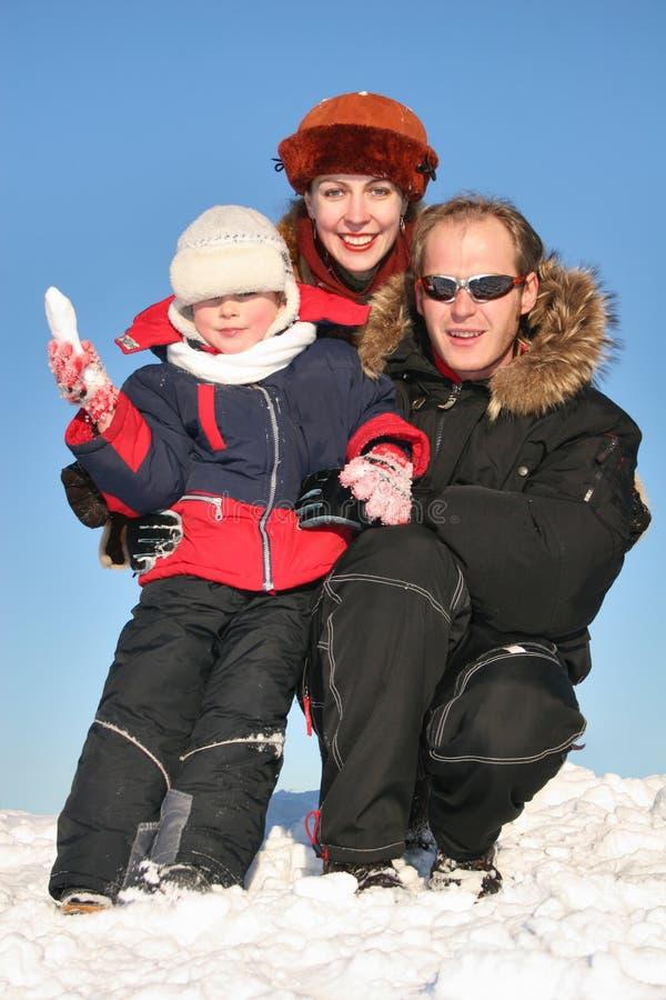 Winter family sit on snow stock photos