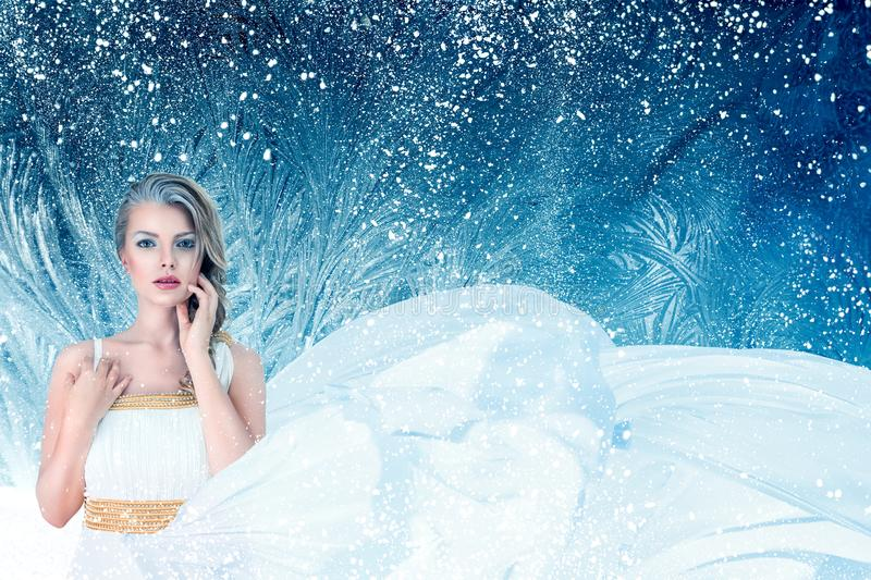 Winter fantasy fashion portrait of young woman stock images