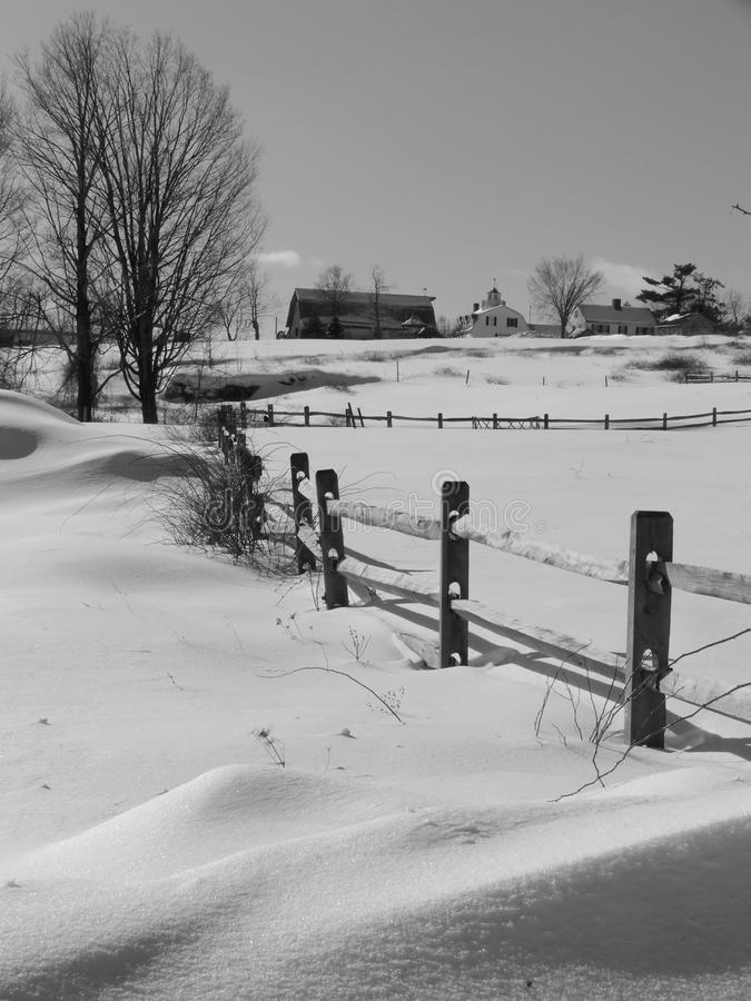 Winter: farm buildings in snow stock photography