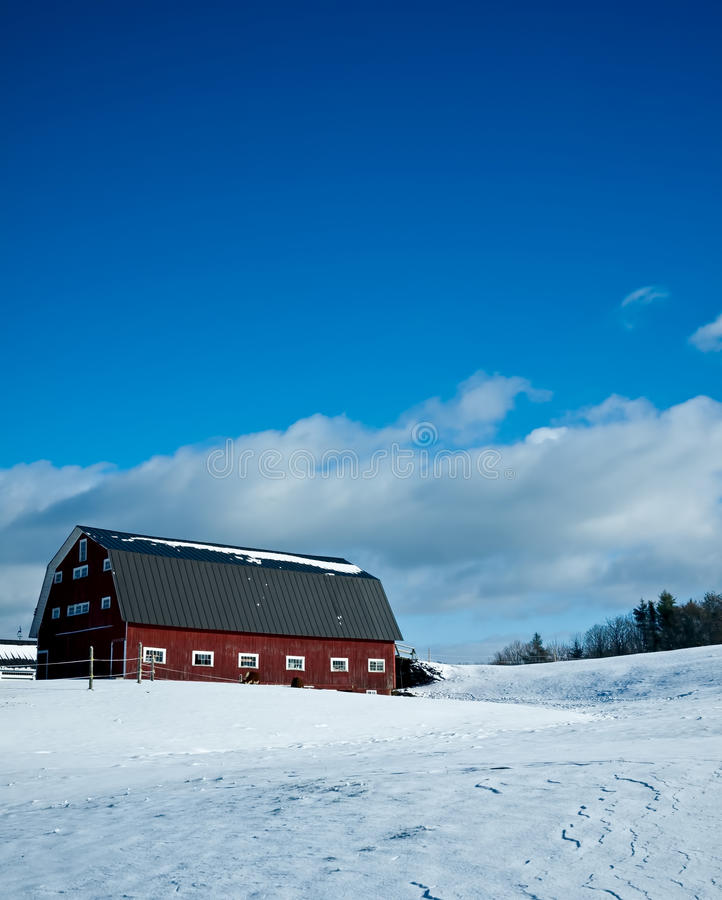 Winter Farm Scene with red barn and snow stock images