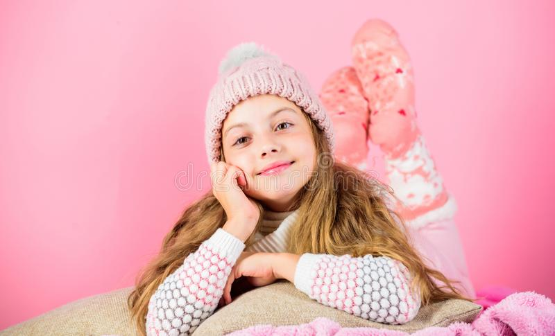 Winter fashion accessory. Kid girl knitted hat and scarf. Winter accessory concept. Girl long hair dream pink background. Kid dreamy wear knitted hat. Winter stock image