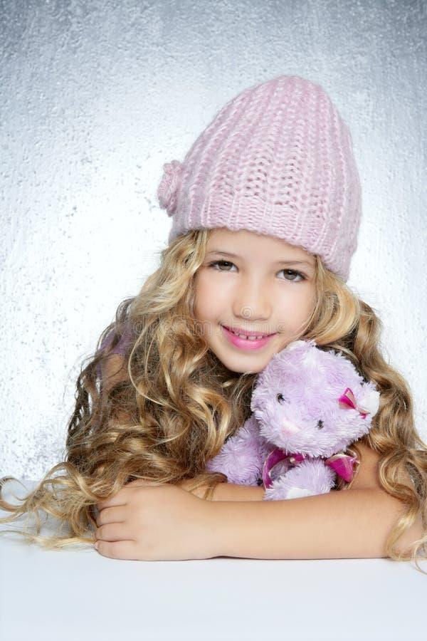 winter little girl hug teddy bear smiling stock image. Black Bedroom Furniture Sets. Home Design Ideas