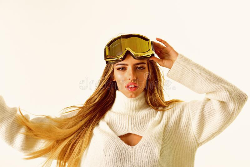 Winter fashion. Cheerful girl. Ski resort and snowboarding. Happy winter holidays. Girl in ski or snowboard wear. Winter. Sport and activity. Sexy woman in royalty free stock photography