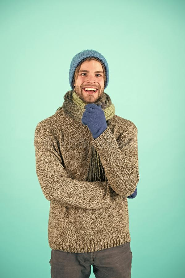 Winter fashion knitted clothes. Knitted accessories as hat and scarf. Man in knitted hat and scarf winter fashion season royalty free stock photography
