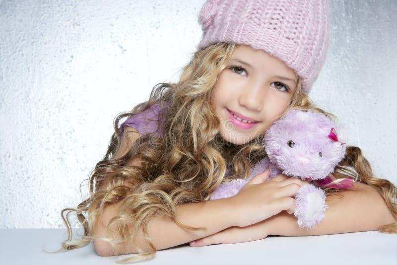 Winter fashion little girl hug teddy bear stock photo