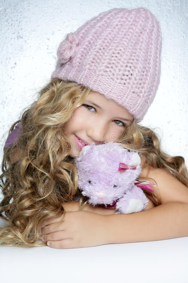 Winter fashion little girl hug teddy bear smiling stock images