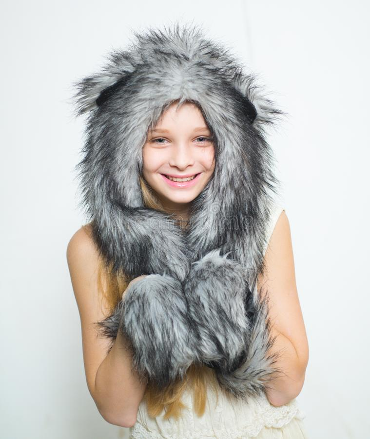 Winter fashion trends for kids. Small fashionista. Happy child smile in fashion style. Small girl wear winter hat scarf. Little girl in winter hat. youth stock image
