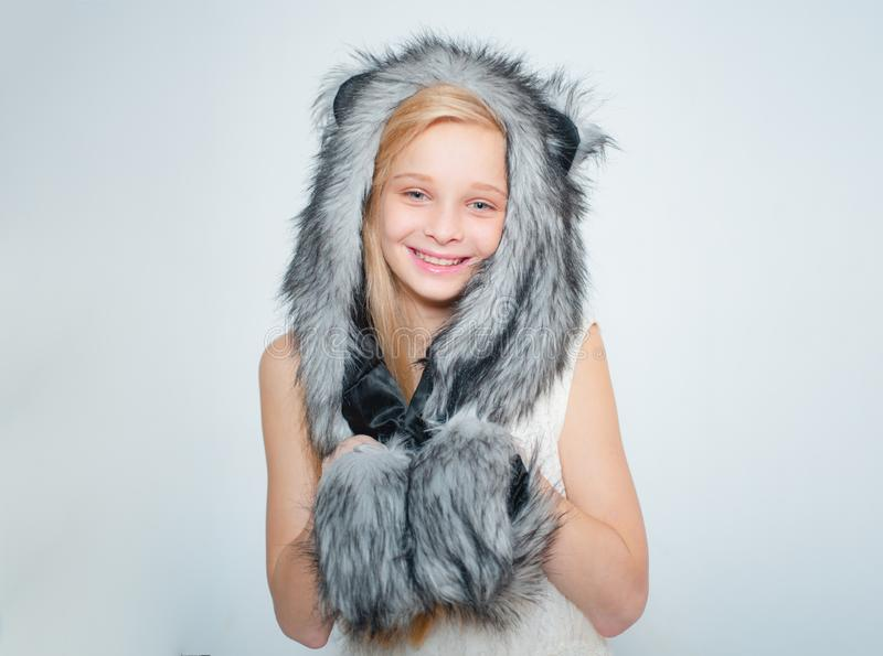 Winter fashion trends for kids. Small fashionista. Happy child smile in fashion style. Small girl wear winter hat scarf royalty free stock photo
