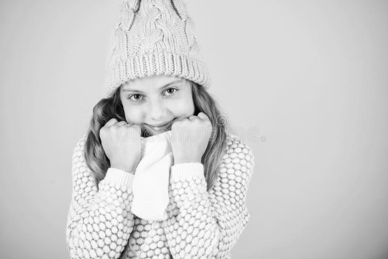 Winter fashion warm clothes concept. Warm accessories that will keep you cozy winter. Child long hair warm woolen hat royalty free stock photo