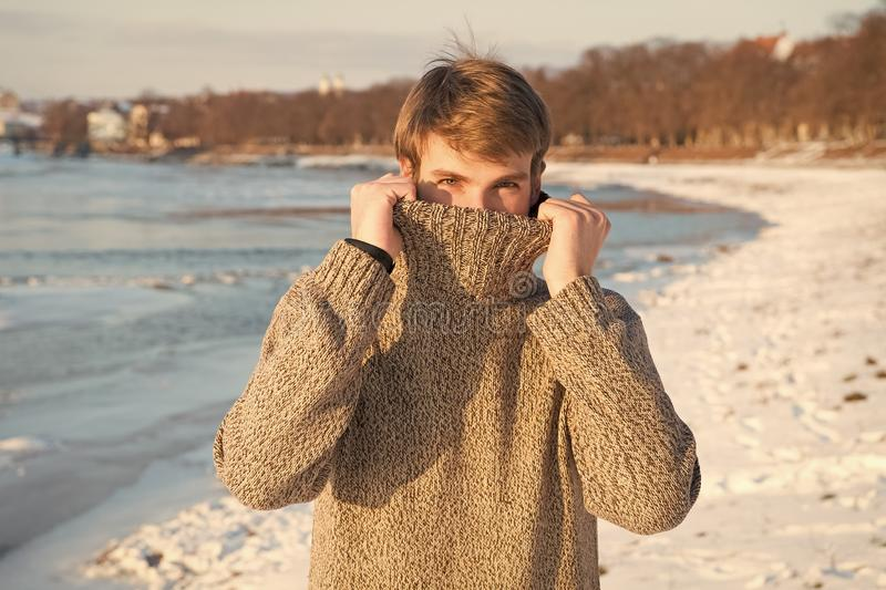 Winter fashion. warm sweater. Sexy man in warm clothes. Warm clothes for cold season. Happy winter holidays. Flu and royalty free stock photography