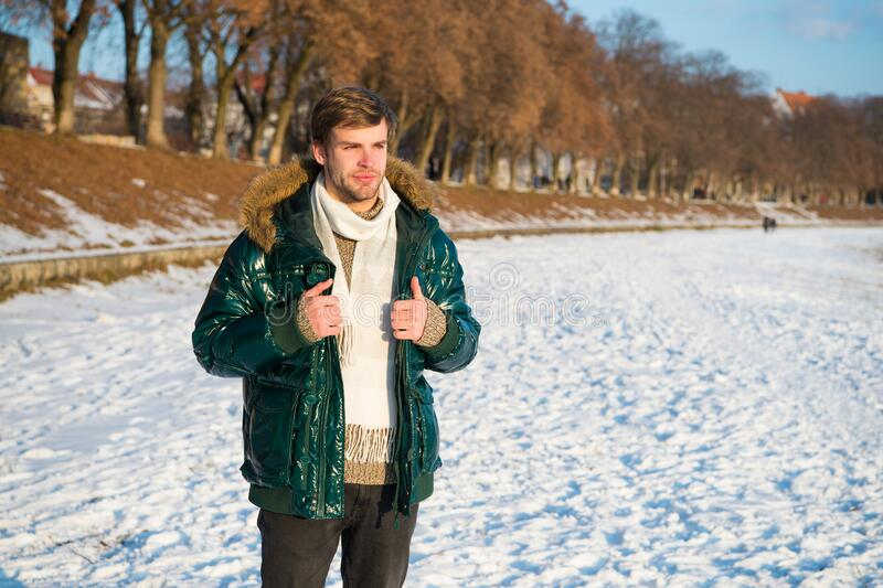 Winter favorable weather conditions. Sunny winter day. Winter menswear. Travel and vacation concept. Winter outfit. Guy royalty free stock image