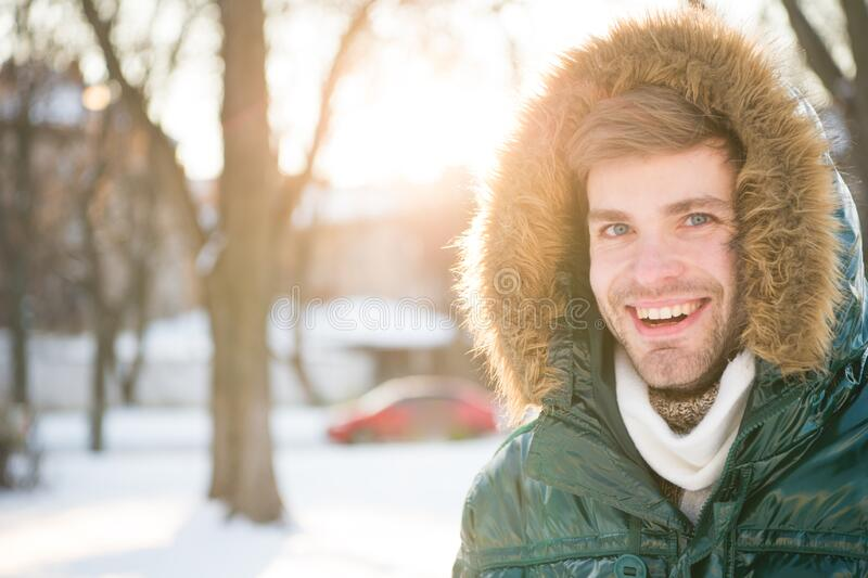 Winter favorable weather conditions. Sunny winter day. Winter menswear. Winter outfit. Hipster fashion outfit. Guy stock image