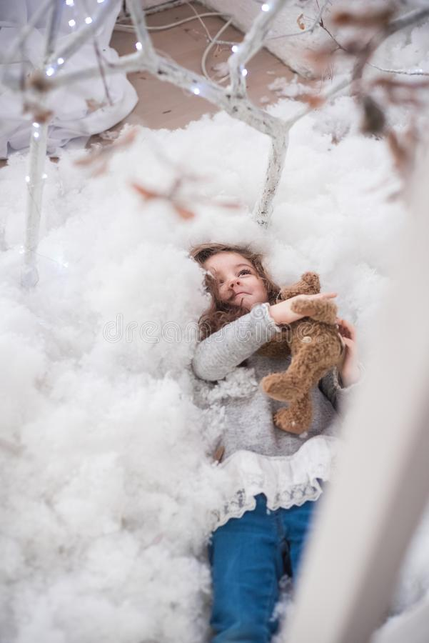 The girl plays with artificial snow royalty free stock photo