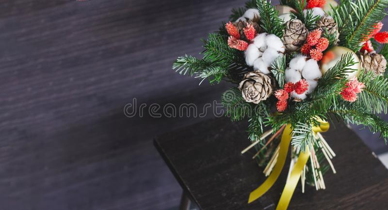 winter fir branches bouquet, Christmas balls and dried flowers, banner royalty free stock photos