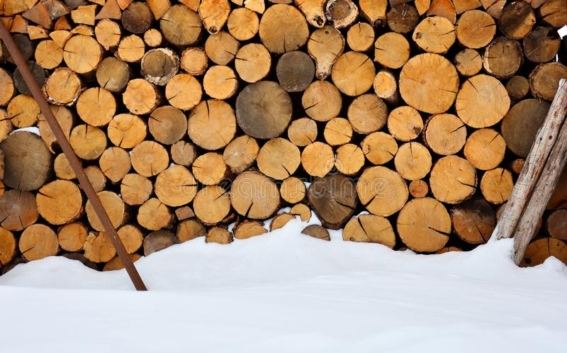 Winter firewood stock near the snow mound. royalty free stock photography