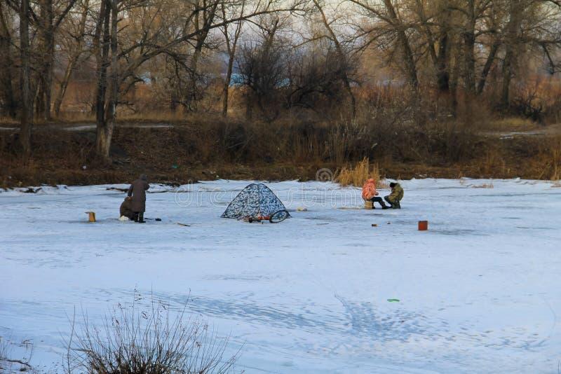 Winter fishing on a frozen lake royalty free stock photo