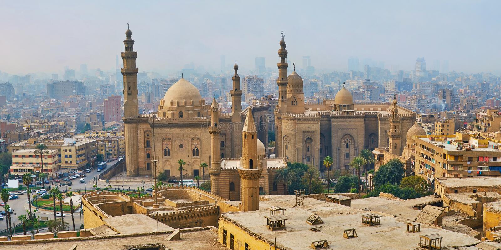 Foggy day in Cairo, Egypt. Winter fog covers the old city, hides its old residential buildings, slums and winding streets, only the giant medieval mosques of Al royalty free stock image